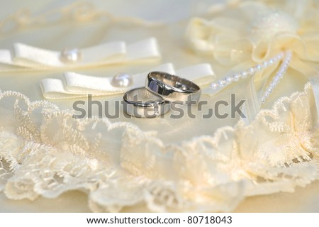 Wedding rings on a support - stock photo