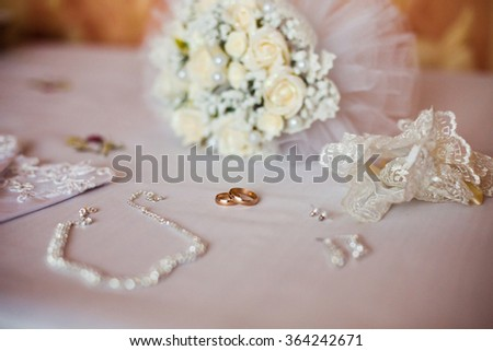 Wedding rings on a white background, infinity sign of the rings, wedding rings and jewelry bride, the morning of the bride  - stock photo