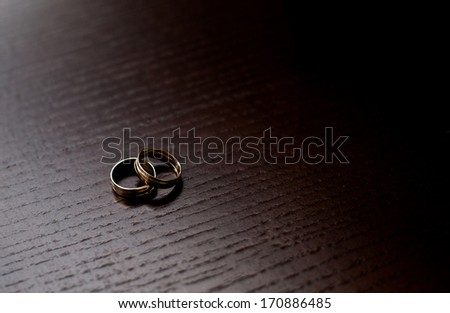 Wedding rings on a wooden background - stock photo