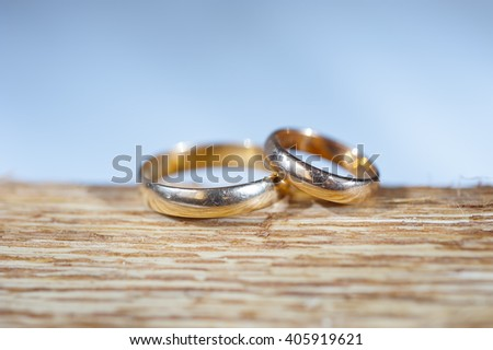Wedding rings on a wooden stand - stock photo