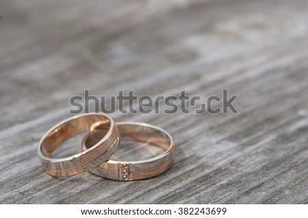 Wedding rings on a wooden surface