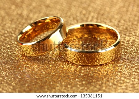 Wedding rings on bright background - stock photo