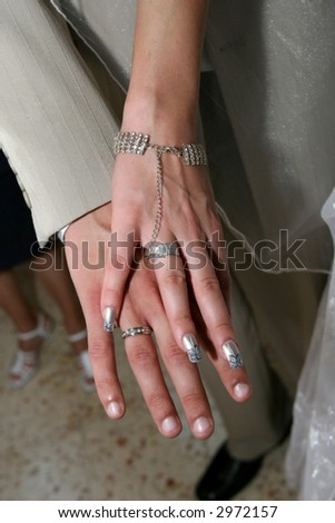 Wedding rings on hands - stock photo