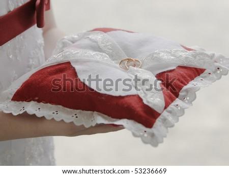 Wedding rings on pillow - stock photo