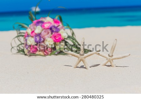 wedding rings on star fish, beach wedding concept, outdoor wedding in tropics - stock photo