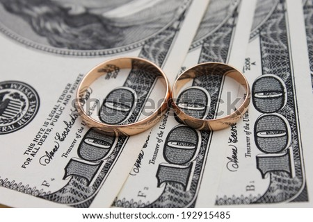 Wedding rings on the background of money - stock photo