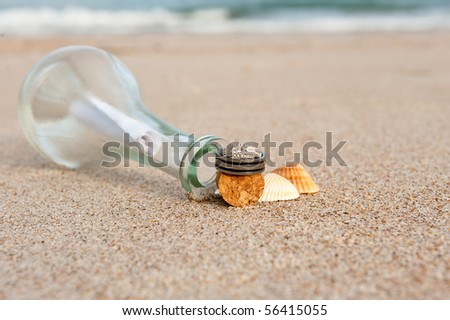 wedding rings on the beach with message - stock photo