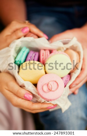 wedding rings on the macarons - stock photo