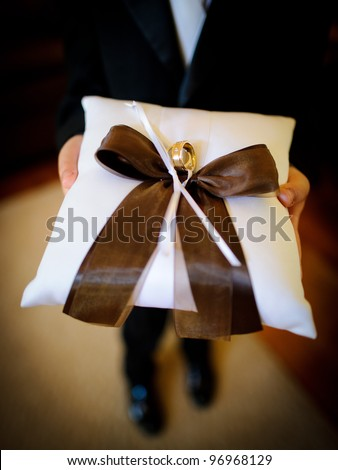 Wedding rings on the pillow - stock photo