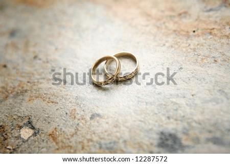 Wedding rings on the stone - stock photo