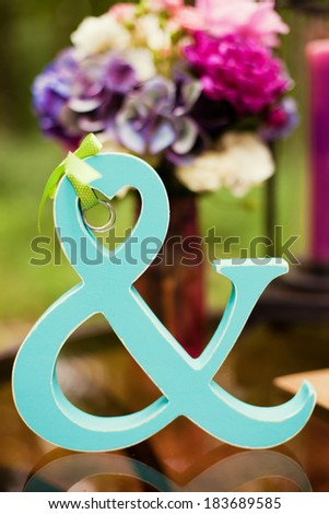 wedding rings on the wooden word - stock photo