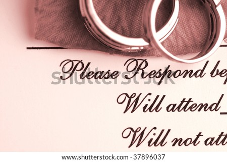Wedding rings on top of a wedding reservation