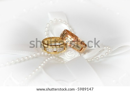 Wedding Rings on white silk and pearl