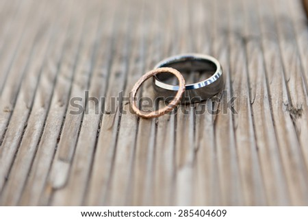 Wedding Rings on wooden old plank - stock photo