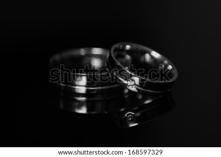 wedding rings onblack background - stock photo