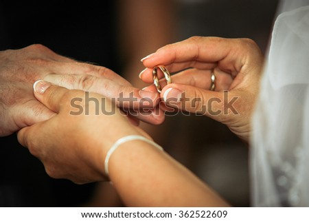 Wedding rings pull - stock photo