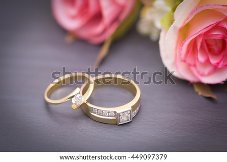 Wedding rings. Wedding symbols, attributes. Holiday, celebration. with blur couple heart and flowers