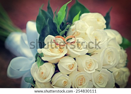 wedding rings with bouquet,  beautiful romance background vintage style effect picture  - stock photo