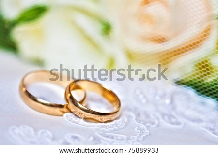 wedding rings with bouquet from roses with a shallow DOF