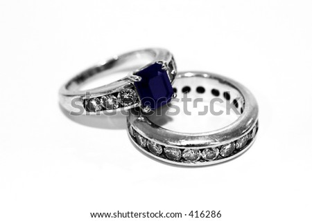 Wedding Rings with Diamonds and Sapphire - stock photo