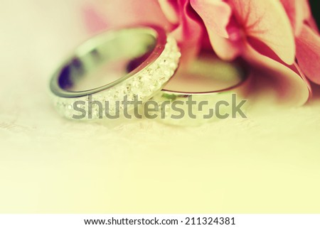 Wedding rings with flowers. - stock photo