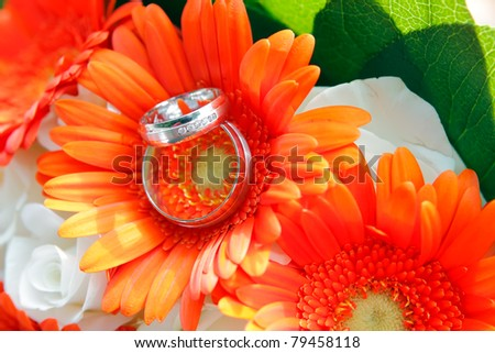 Wedding rings with sunflowers - stock photo