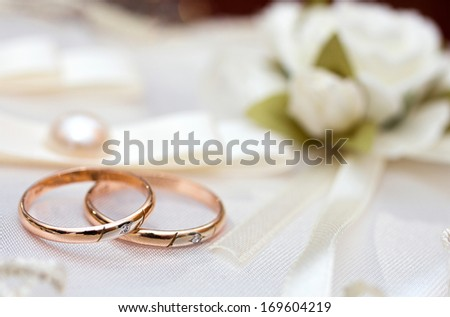 wedding rings with wedding decoration - stock photo