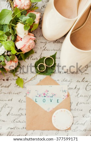 Wedding rings with wedding invitations - stock photo