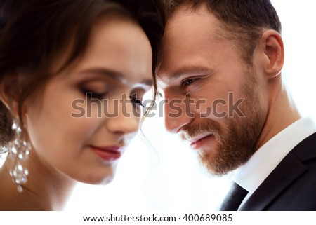 Wedding season â?? lovely young couple in a luxury interior. Handsome bearded man and lovely slim bride. - stock photo