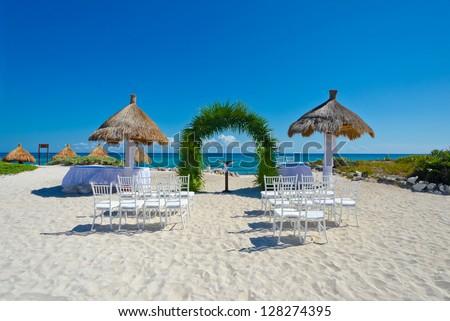 Wedding set at the tropical beach. Decoration at the beach wedding venue - stock photo