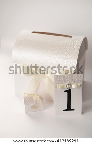Wedding set. Number of the table, a chest of money and a box of chocolates. Color Ivory. Decoration ribbon. - stock photo