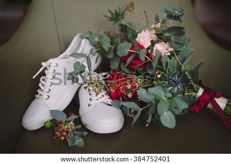 wedding set of bridal bouquet and white sport shoes and groom boutonniere - stock photo