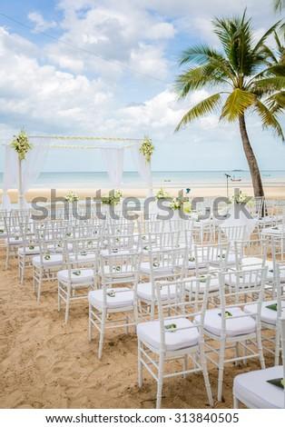 Wedding setting on a tropical beach - stock photo