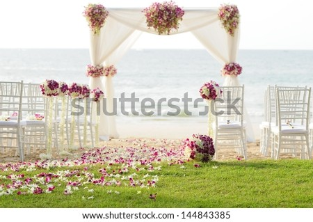 Wedding setting on the beach - stock photo