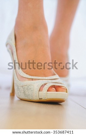wedding shoe with crystals and lace on bride - stock photo