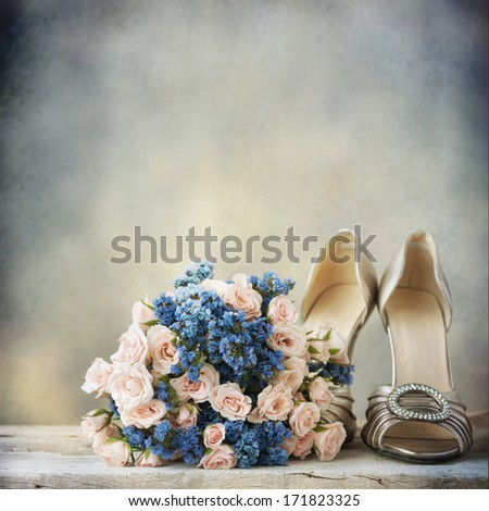 Wedding shoes and bouquet - stock photo