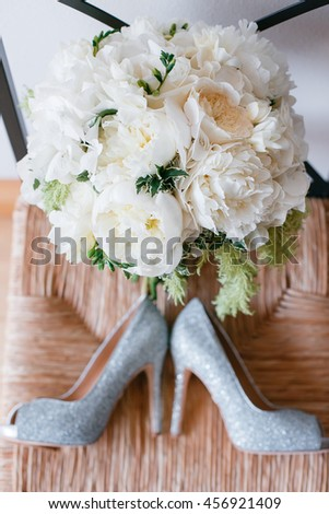 wedding shoes and  bouquet of white Garden rose  peony - stock photo