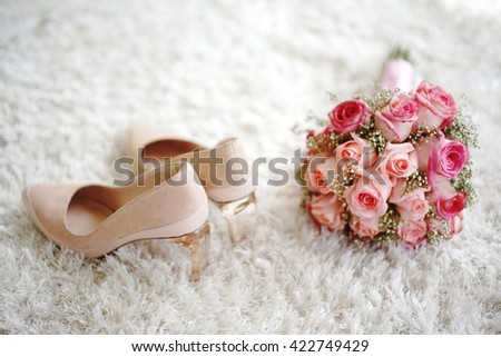 wedding shoes and wedding bouquet of pink roses - stock photo