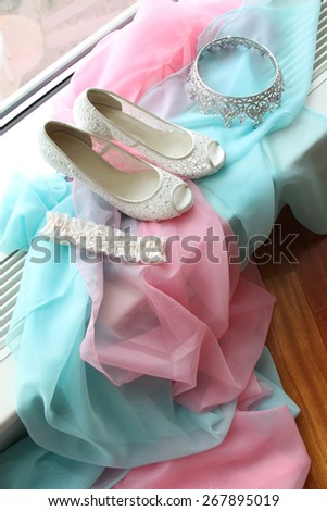wedding shoes , garter, crown - stock photo