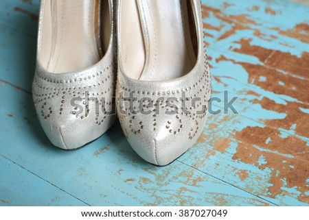 Wedding shoes on the wooden floor, women shoes, close up - stock photo