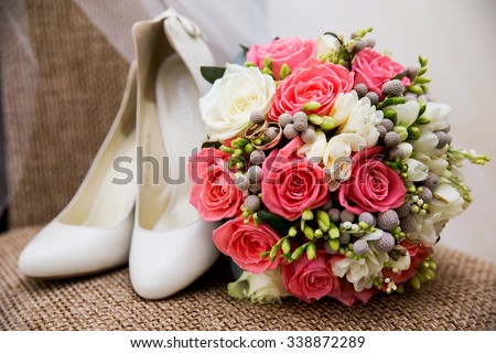 wedding shoes rings and bouquet marriage wedding - stock photo