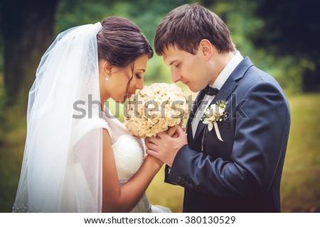 Wedding shot of bride and groom - stock photo