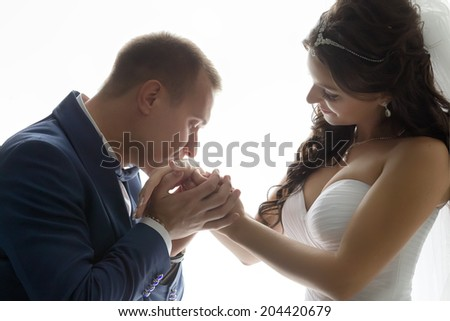Wedding shot of bride and groom next to window - stock photo