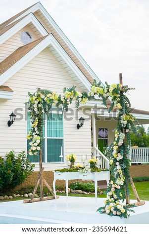 wedding stage with table set and backdrop in western style house - stock photo