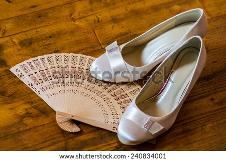 Wedding still life - bridal court shoes and fan - stock photo