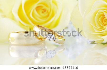 Wedding still life with beautiful golden rings - stock photo