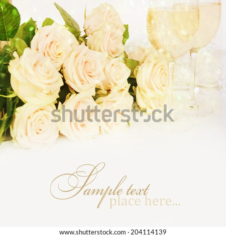 Wedding still life with cremy roses and glass of champagne - stock photo