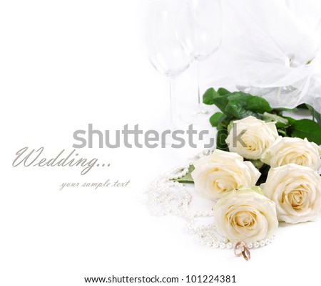 Wedding still life with white roses, golden rings, pearls and goblet - stock photo