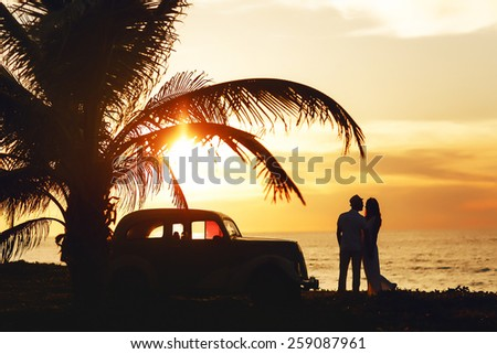 Wedding sunny couple in Cuba near the sea - stock photo
