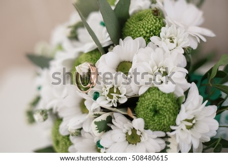 wedding symbol golden rings background flowers tradition